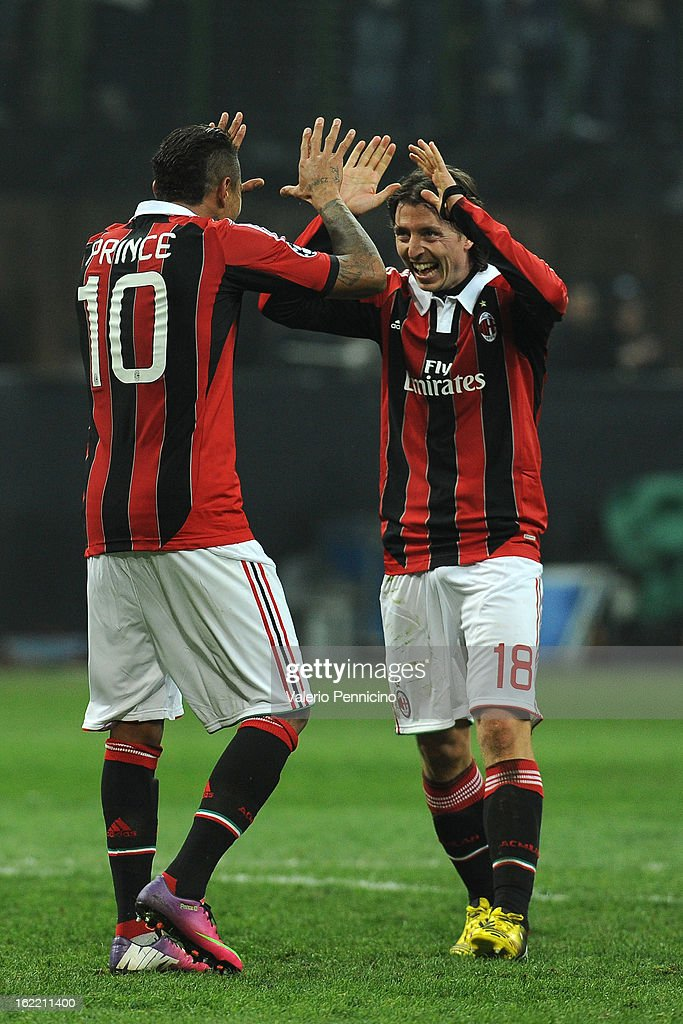 Riccardo Montolivo (R) of AC Milan celebrates victory with Kevin-Prince Boateng at the end of the UEFA Champions League Round of 16 first leg match between AC Milan and Barcelona at San Siro Stadium on February 20, 2013 in Milan, Italy.