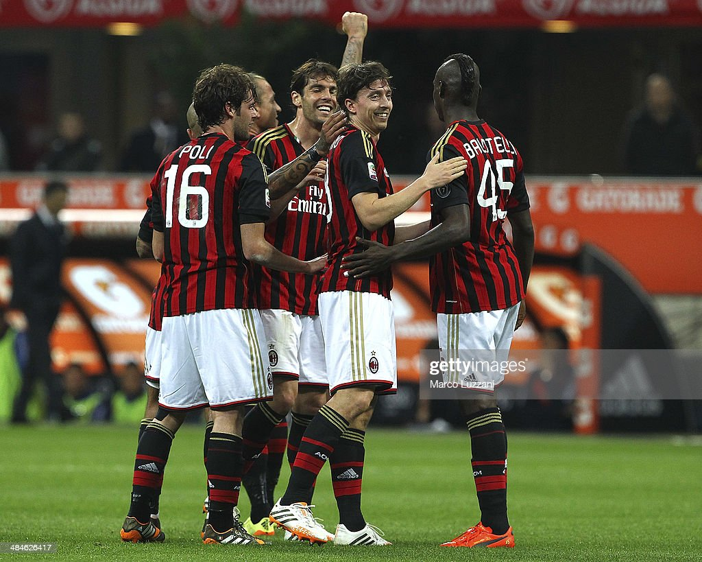 Riccardo Montolivo (2nd R) of AC Milan celebrates with his team-mates (L-R) Andrea Poli, Ricardo Kaka and Mario Balotelli after scoring the opening goal during the Serie A match between AC Milan and Calcio Catania at San Siro Stadium on April 13, 2014 in Milan, Italy.