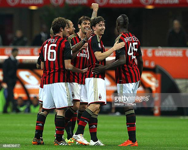 Riccardo Montolivo of AC Milan celebrates with his teammates Andrea Poli Ricardo Kaka and Mario Balotelli after scoring the opening goal during the...