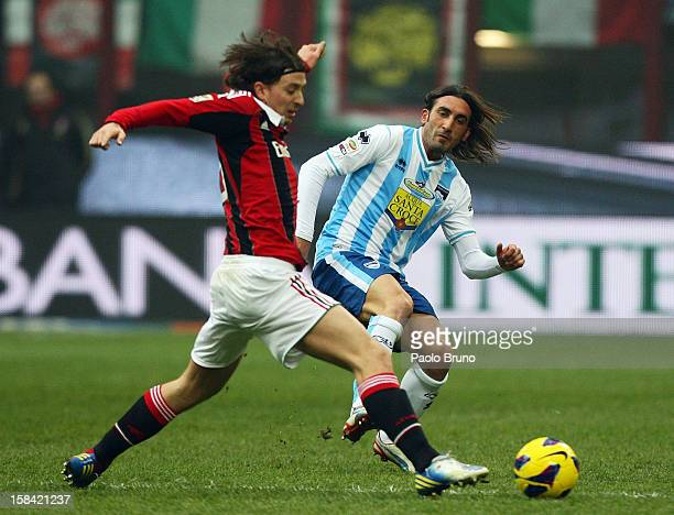 Riccardo Montolivo of AC Milan competes for the ball with Francesco Modesto of Pescara during the Serie A match between AC Milan and Pescara at San...