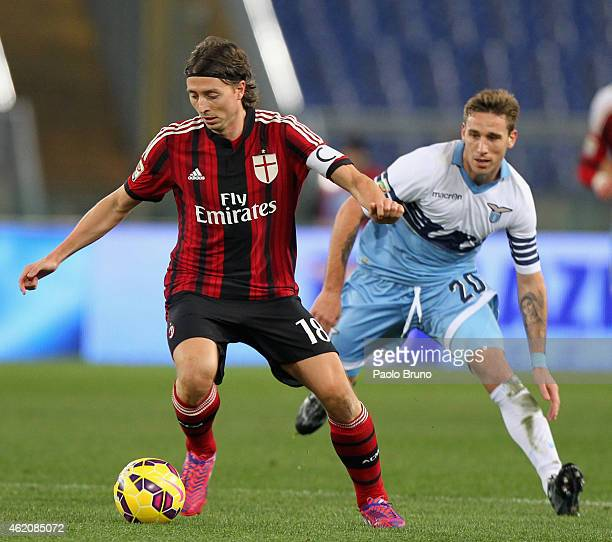 Riccardo Montolivo of AC Milan competes for the ball with Lucas Biglia of SS Lazio during the Serie A match between SS Lazio and AC Milan at Stadio...