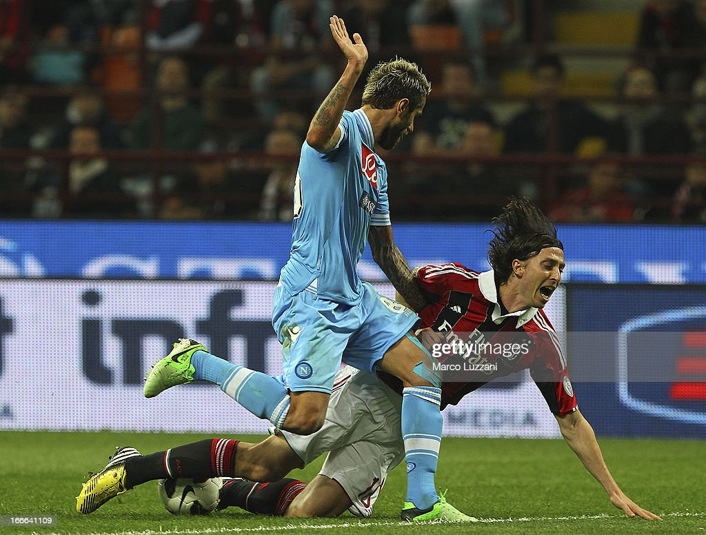 <a gi-track='captionPersonalityLinkClicked' href=/galleries/search?phrase=Riccardo+Montolivo&family=editorial&specificpeople=605846 ng-click='$event.stopPropagation()'>Riccardo Montolivo</a> of AC Milan competes for the ball with <a gi-track='captionPersonalityLinkClicked' href=/galleries/search?phrase=Valon+Behrami&family=editorial&specificpeople=453450 ng-click='$event.stopPropagation()'>Valon Behrami</a> of SSC Napoli during the Serie A match between AC Milan and SSC Napoli at San Siro Stadium on April 14, 2013 in Milan, Italy.
