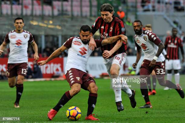 Riccardo Montolivo of AC Milan competes fot the ball with Tomas Rincon of Torino FC during Italian serie A match AC Milan vs Torino FC at San Siro...