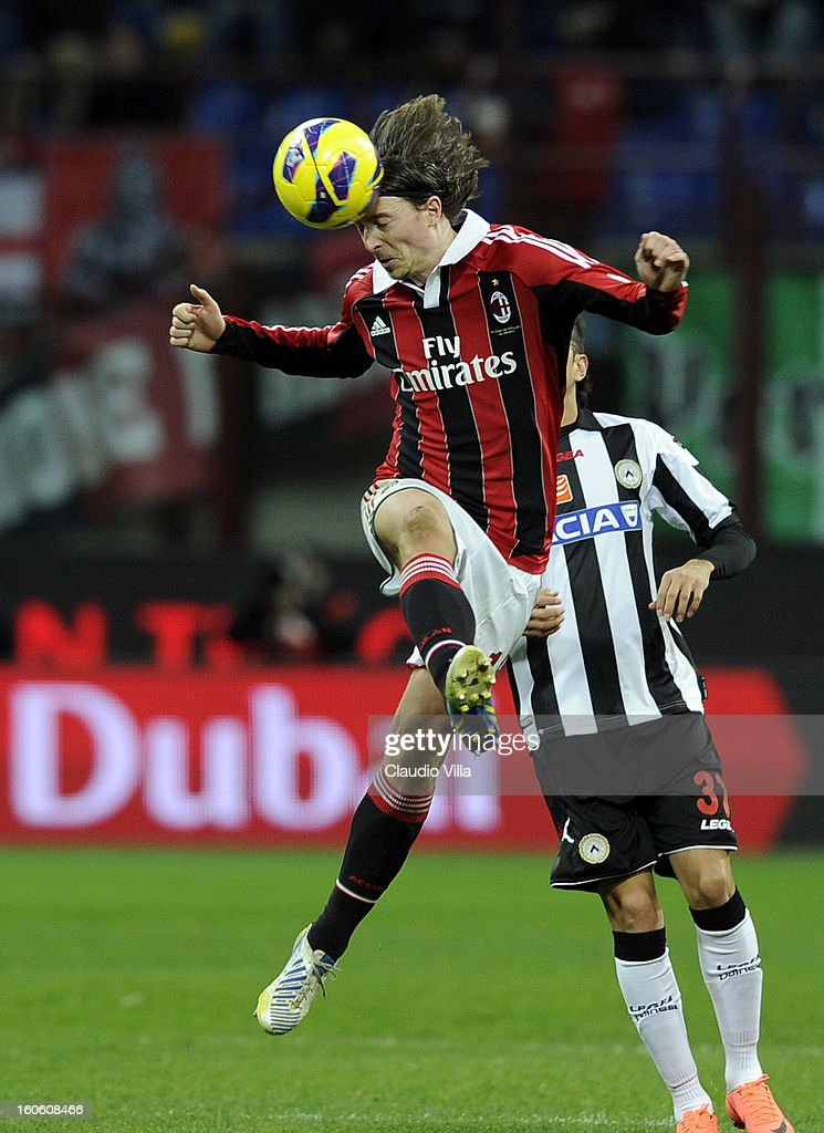Riccardo Montolivo of AC Milan heads the ball during the Serie A match between AC Milan and Udinese Calcio at San Siro Stadium on February 3, 2013 in Milan, Italy.