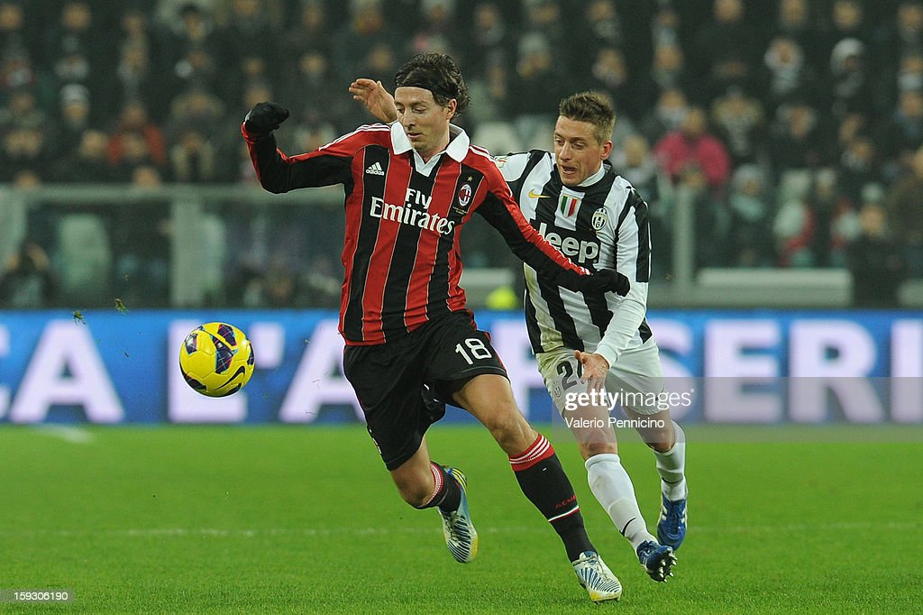 Riccardo Montolivo (L) of AC Milan in action against Emanuele Giaccherini of Juventus FC during the TIM cup match between Juventus FC and AC Milan at Juventus Arena on January 9, 2013 in Turin, Italy.