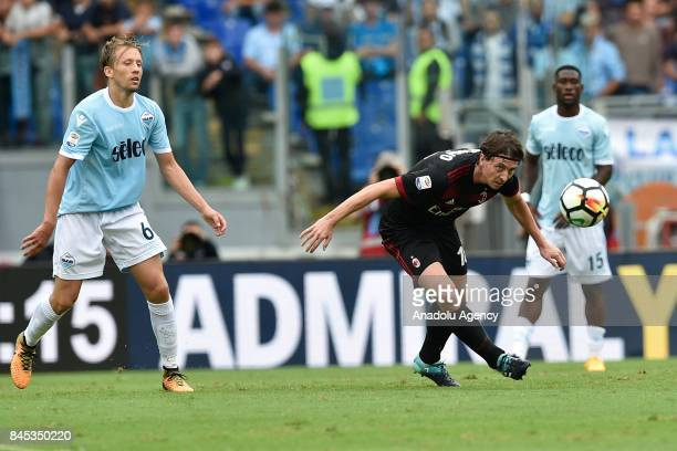 Riccardo Montolivo of AC Milan in action against LucasLeiva Pezzini of SS Lazio during the Serie A soccer match between SS Lazio and AC Milan Stadio...