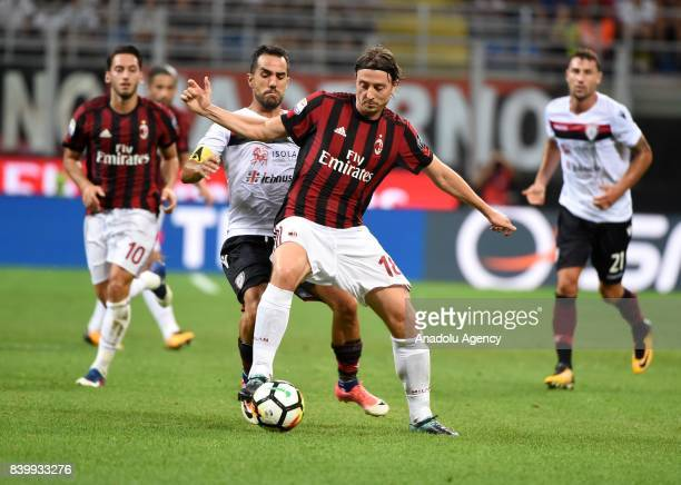Riccardo Montolivo of AC Milan in action against Marco Sau of Cagliari Calcio during Serie A soccer match between AC Milan and Cagliari Calcio at San...