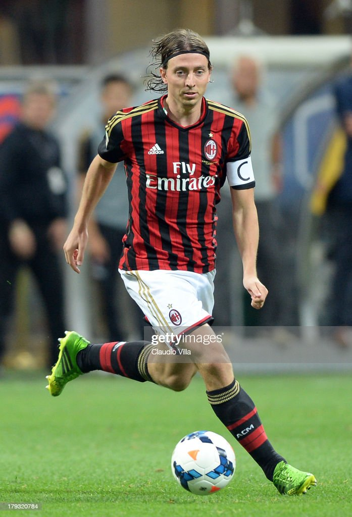 <a gi-track='captionPersonalityLinkClicked' href=/galleries/search?phrase=Riccardo+Montolivo&family=editorial&specificpeople=605846 ng-click='$event.stopPropagation()'>Riccardo Montolivo</a> of AC Milan in action during the Serie A match between AC Milan and Cagliari Calcio at San Siro Stadium on September 1, 2013 in Milan, Italy.