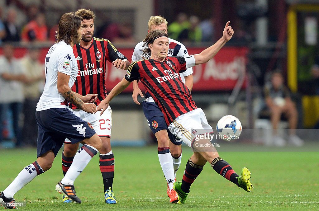 <a gi-track='captionPersonalityLinkClicked' href=/galleries/search?phrase=Riccardo+Montolivo&family=editorial&specificpeople=605846 ng-click='$event.stopPropagation()'>Riccardo Montolivo</a> of AC Milan (C) in action during the Serie A match between AC Milan and Cagliari Calcio at San Siro Stadium on September 1, 2013 in Milan, Italy.