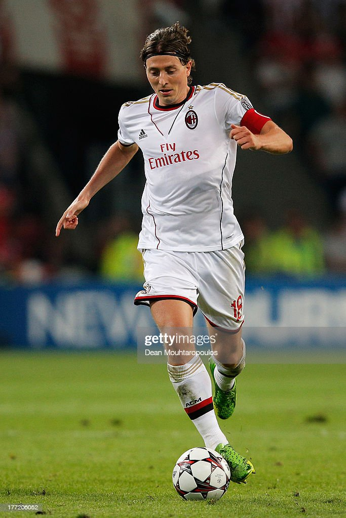 <a gi-track='captionPersonalityLinkClicked' href=/galleries/search?phrase=Riccardo+Montolivo&family=editorial&specificpeople=605846 ng-click='$event.stopPropagation()'>Riccardo Montolivo</a> of AC Milan in action during the UEFA Champions League Play-off First Leg match between PSV Eindhoven and AC Milan at PSV Stadion on August 20, 2013 in Eindhoven, Netherlands.