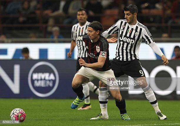 Riccardo Montolivo of AC Milan is challenged by Alvaro Morata of Juventus FC during the Serie A match between AC Milan and Juventus FC at Stadio...