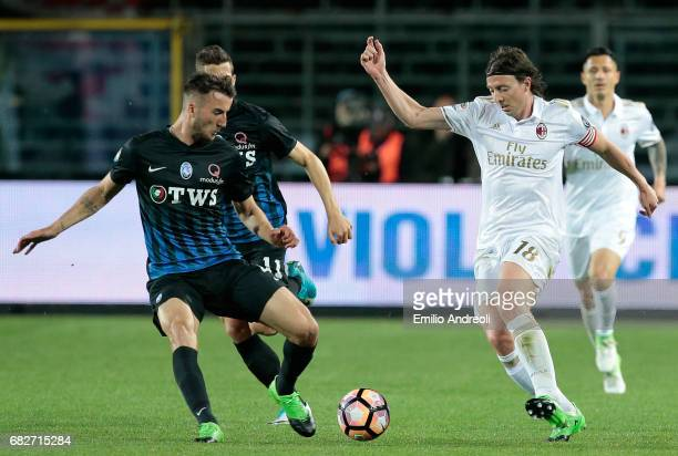 Riccardo Montolivo of AC Milan is challenged by Bryan Cristante of Atalanta BC during the Serie A match between Atalanta BC and AC Milan at Stadio...
