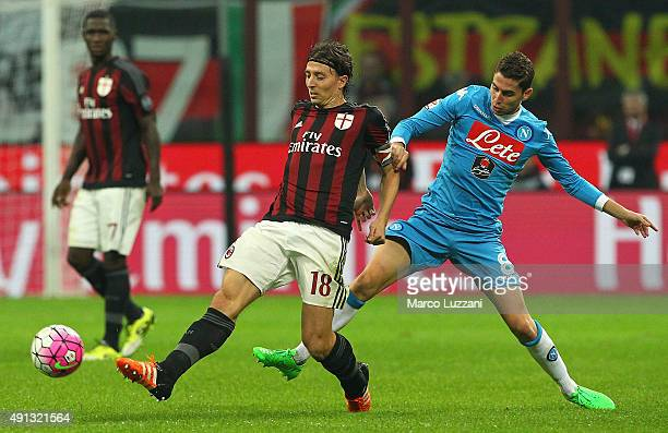 Riccardo Montolivo of AC Milan is challenged by Jorge Luiz Frello Jorginho of SSC Napoli during the Serie A match between AC Milan and SSC Napoli at...