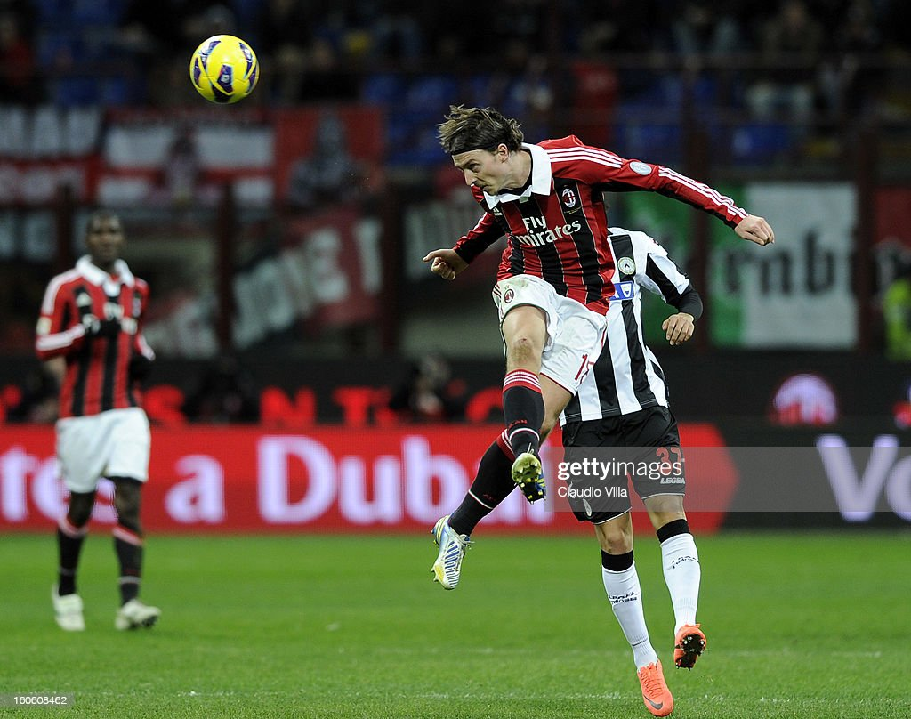 Riccardo Montolivo of AC Milan jumps and headsa the ball during the Serie A match between AC Milan and Udinese Calcio at San Siro Stadium on February 3, 2013 in Milan, Italy.