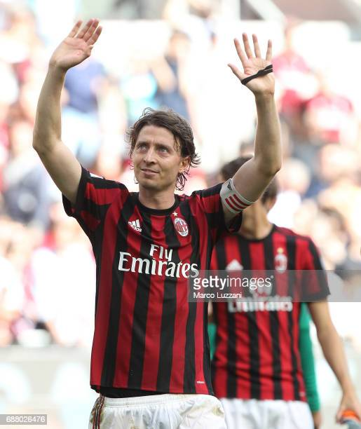 Riccardo Montolivo of AC Milan salutes the fans at the end of the Serie A match between AC Milan and Bologna FC at Stadio Giuseppe Meazza on May 21...