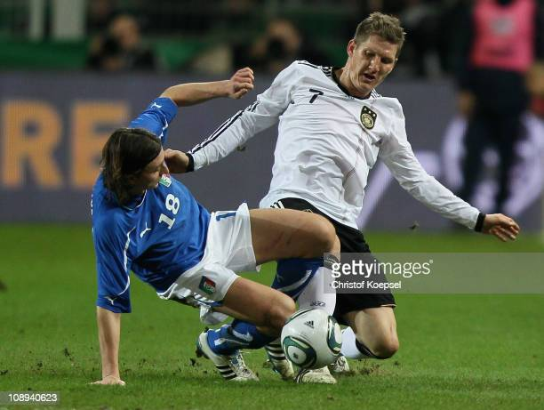 Riccardo Montolivo of Italy challenges Bastian Schweinsteiger of Germany during the International Friendly match between Germany and Italy at Signal...