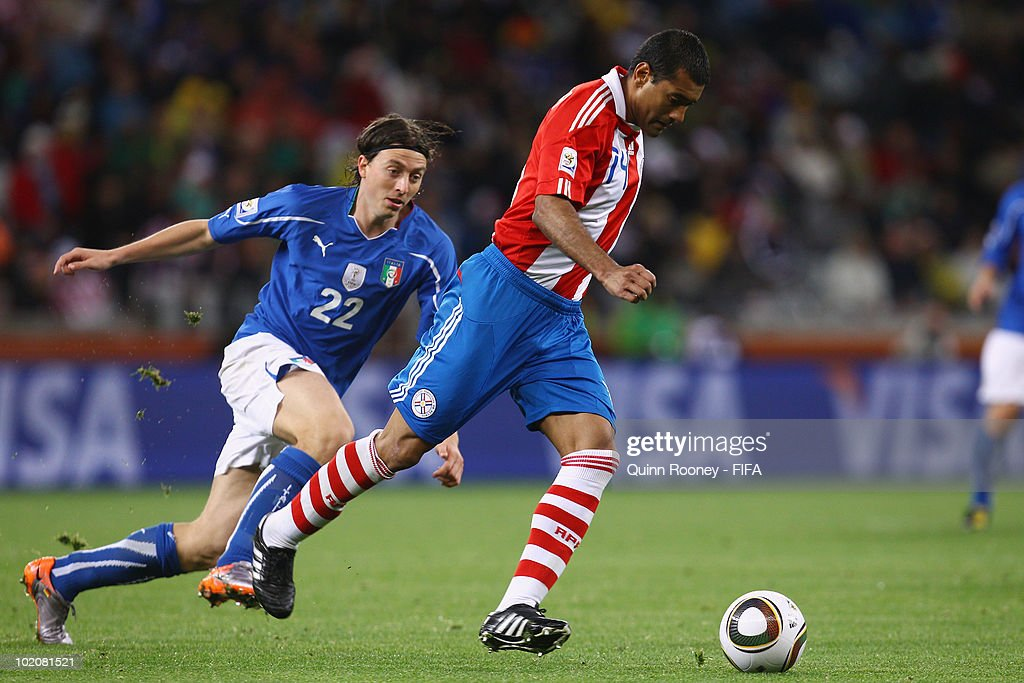 <a gi-track='captionPersonalityLinkClicked' href=/galleries/search?phrase=Riccardo+Montolivo&family=editorial&specificpeople=605846 ng-click='$event.stopPropagation()'>Riccardo Montolivo</a> of Italy chases <a gi-track='captionPersonalityLinkClicked' href=/galleries/search?phrase=Paulo+Da+Silva&family=editorial&specificpeople=553931 ng-click='$event.stopPropagation()'>Paulo Da Silva</a> of Paraguay during the 2010 FIFA World Cup South Africa Group F match between Italy and Paraguay at Green Point Stadium on June 14, 2010 in Cape Town, South Africa.