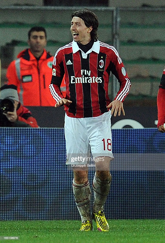 Riccardo Montolivo of Milan celebrates after scoring the opening goal during the Serie A match between AC Chievo Verona and AC Milan at Stadio Marc'Antonio Bentegodi on March 30, 2013 in Verona, Italy.