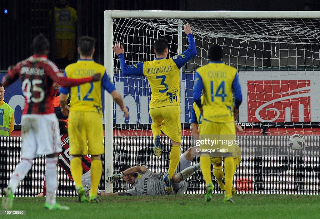 Riccardo Montolivo of Milan scores the opening goal during the Serie A match between AC Chievo Verona and AC Milan at Stadio Marc'Antonio Bentegodi on March 30, 2013 in Verona, Italy.