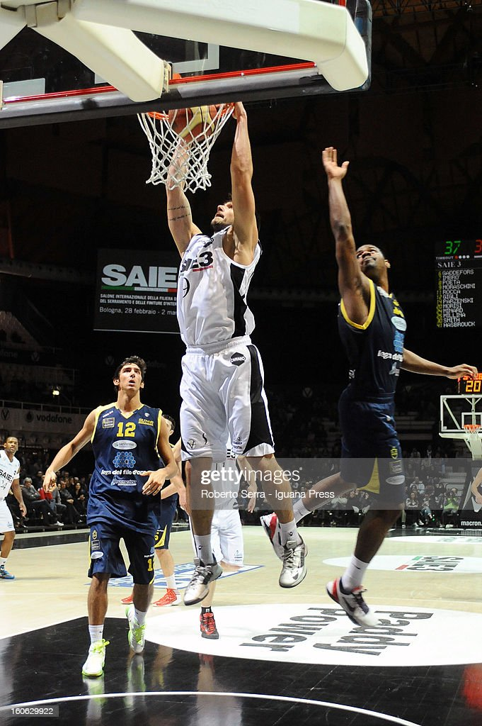 Riccardo Moraschini of SAIE3 competes with Luca Campani #9 and Kyle Johnson #15 of Sutor during the LegaBasket Serie A match between Virtus Bologna SAIE3 and Sutor Montegranaro at Unipol Arena on February 3, 2013 in Bologna, Italy.