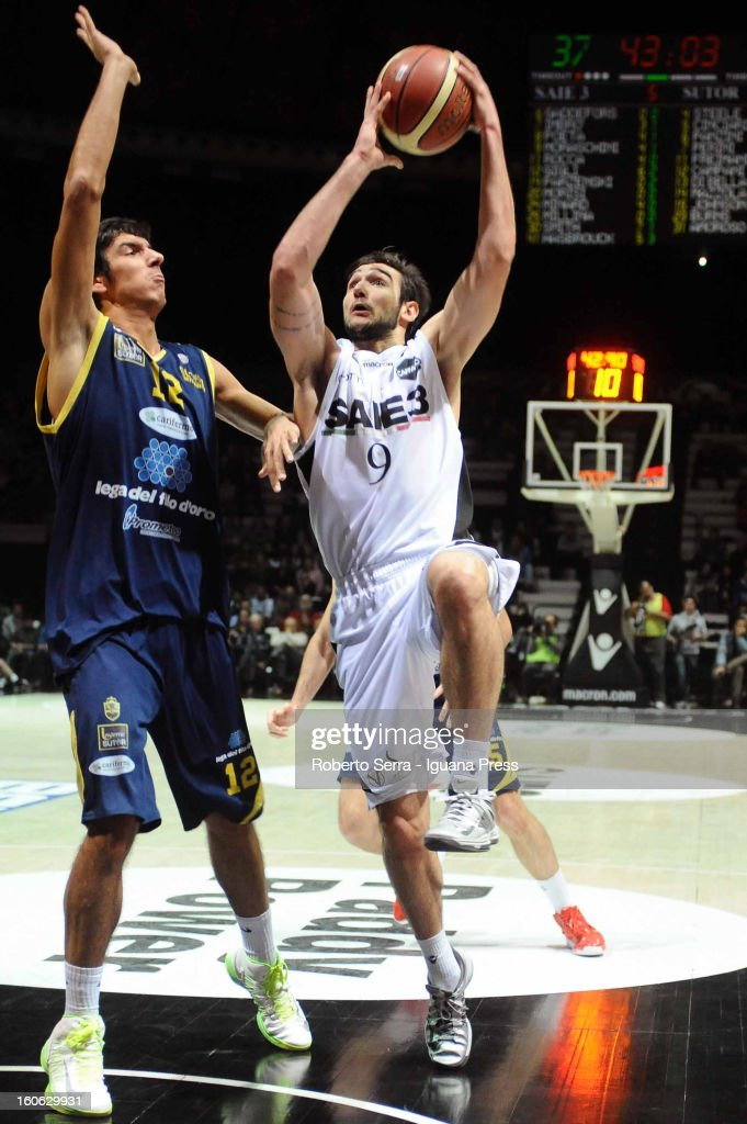 Riccardo Moraschini of SAIE3 competes with Luca Campani of Sutor during the LegaBasket Serie A match between Virtus Bologna SAIE3 and Sutor Montegranaro at Unipol Arena on February 3, 2013 in Bologna, Italy.