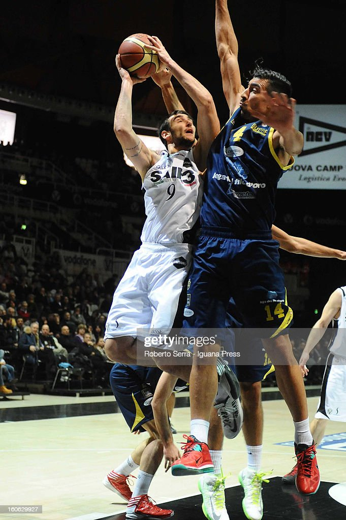 Riccardo Moraschini of SAIE3 competes with Valerio Mazzola of Sutor during the LegaBasket Serie A match between Virtus Bologna SAIE3 and Sutor Montegranaro at Unipol Arena on February 3, 2013 in Bologna, Italy.