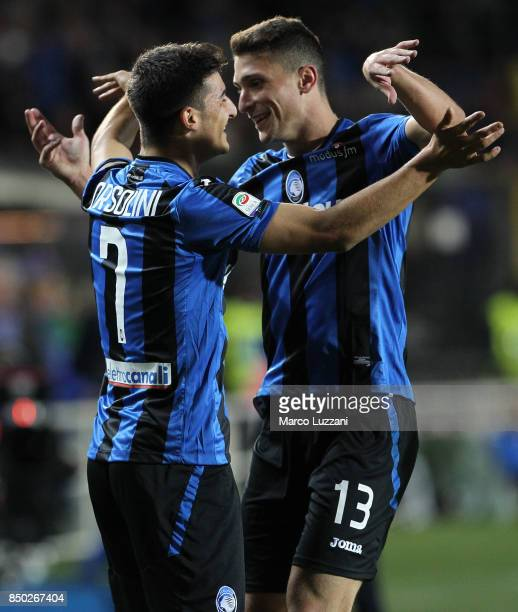 Riccardo Orsolini of Atalanta BC celebrates his goal with his teammate Mattia Caldara during the Serie A match between Atalanta BC and FC Crotone at...