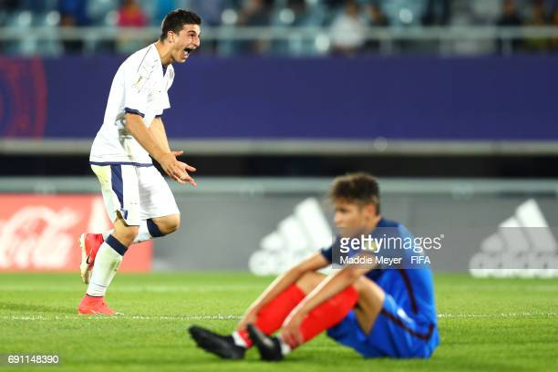 Riccardo Orsolini of Italy celebrates in front of Amine Harit of France after Italy defeat France 21 during the FIFA U20 World Cup Korea Republic...