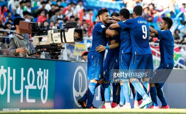Riccardo Orsolini of Italy celebrates with team mates after scoring his teams first goal infront of a tv camera during the FIFA U20 World Cup Korea...