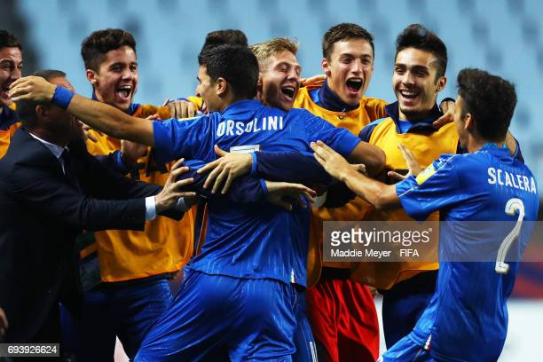 Riccardo Orsolini of Italy celebrates with teammates after scoring a goal during the FIFA U20 World Cup Korea Republic 2017 Semi Final match between...