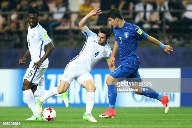 Riccardo Orsolini of Italy defends Lewis Cook of England during the FIFA U20 World Cup Korea Republic 2017 Semi Final match between Italy and England...