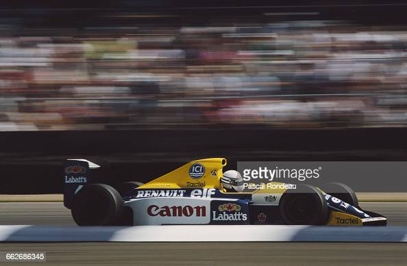 Riccardo Patrese of Italy drives the Canon Williams Renault Williams FW13B Renault V10 during the British Grand Prix on 15 July 1990 at the...