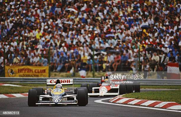 Riccardo Patrese of Italy drives the Canon Williams Team Williams FW12C Renault RS1 V10 ahead of Ayrton Senna of Brazil driving the Honda Marlboro...