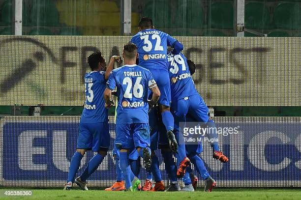 Riccardo Saponara celebrates with team mates after scoring the opening goal during the Serie A match between US Citta di Palermo and Empoli FC at...