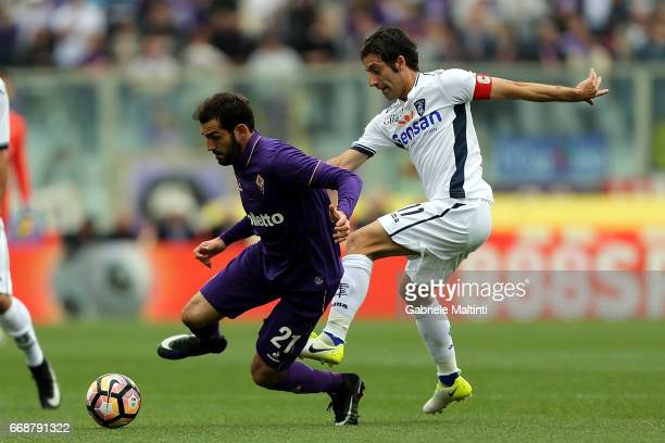 Riccardo Saponara of ACF Fiorentina battles for the ball with Daniele Croce of Empoli FC during the Serie A match between ACF Fiorentina and Empoli...