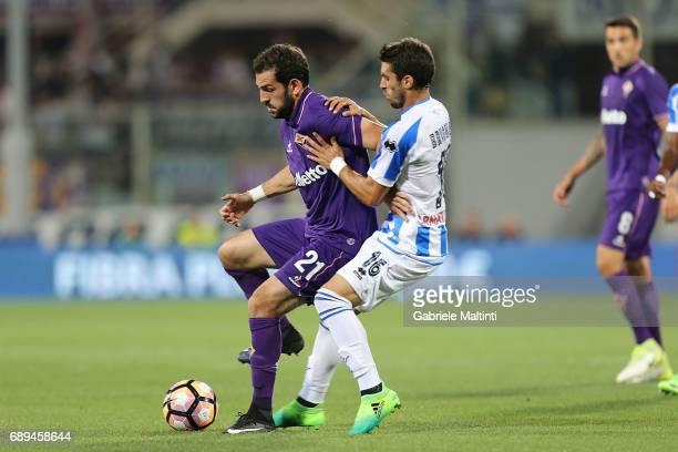 Riccardo Saponara of ACF Fiorentina battles for the ball with Gaston Brugman of Pescara Calcio during the Serie A match between ACF Fiorentina and...