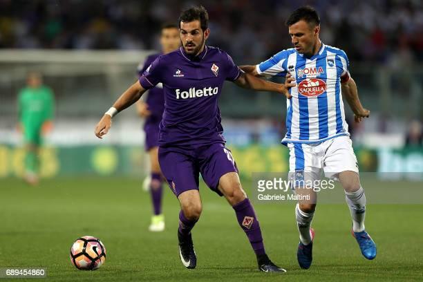 Riccardo Saponara of ACF Fiorentina battles for the ball with Ledian Memushaj of Pescara Calcio during the Serie A match between ACF Fiorentina and...