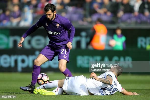 Riccardo Saponara of ACF Fiorentina battles for the ball with Nicolo' Barrella of Cagliari Calcio during the Serie A match between ACF Fiorentina and...