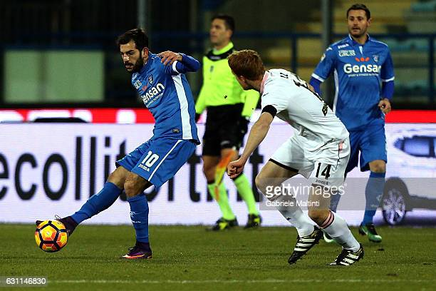 Riccardo Saponara of Empoli FC battles for the ball with Alessandro Gazzi of US Citta' di Palermo during the Serie A match between Empoli FC and US...