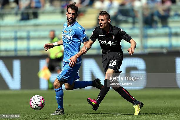 Riccardo Saponara of Empoli FC battles for the ball with Anthony Mounier of Bologna Fc during the Serie A match between Empoli FC and Bologna FC at...