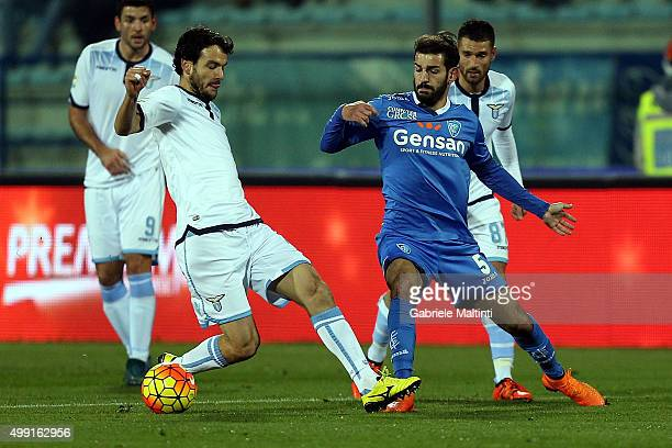 Riccardo Saponara of Empoli FC battles for the ball with Marco Parolo of SS Lazio during the Serie A match between Empoli FC and SS Lazio at Stadio...