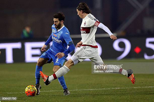 Riccardo Saponara of Empoli FC battles for the ball with Riccardo Montolivo of AC Milan during the Serie A match between Empoli FC and AC Milan at...