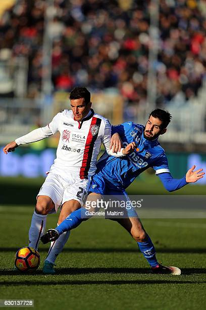 Riccardo Saponara of Empoli FC battles for the ball with Simone Padoin of Cagliari Calcio during the Serie A match between Empoli FC and Cagliari...