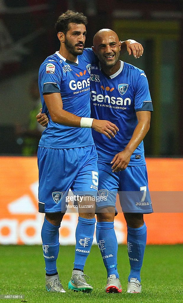 Riccardo Saponara (L) of Empoli FC celebrates his goal with his team-mate Massimo Maccarone (R) during the Serie A match between AC Milan and Empoli FC at Stadio Giuseppe Meazza on August 29, 2015 in Milan, Italy.