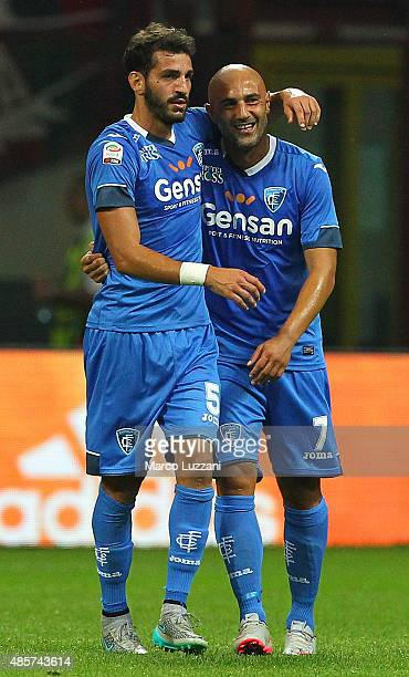Riccardo Saponara of Empoli FC celebrates his goal with his teammate Massimo Maccarone during the Serie A match between AC Milan and Empoli FC at...