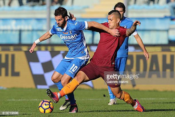 Riccardo Saponara of Empoli Fc for the ball with Leandro Paredes of AS Roma during the Serie A match between Empoli FC and AS Roma at Stadio Carlo...