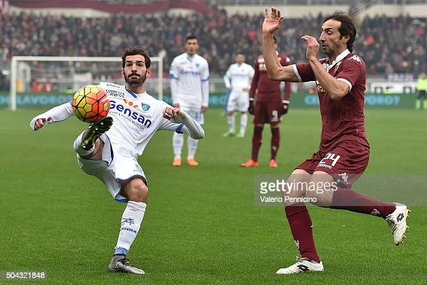 Riccardo Saponara of Empoli FC in action against Emiliano Moretti of Torino FC during the Serie A match between Torino FC and Empoli FC at Stadio...