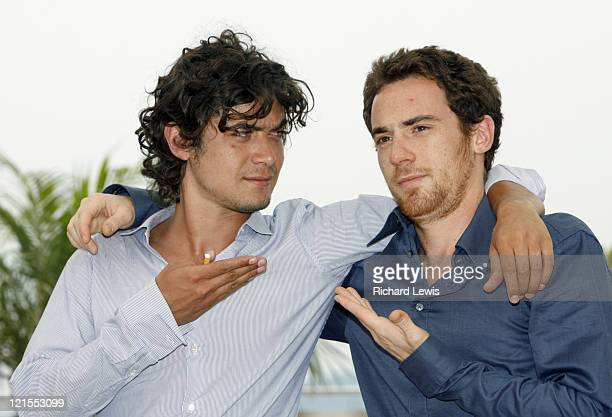 Riccardo Scamarcio and Elio Germano during 2007 Cannes Film Festival 'Mon Frere est Fils Unique' Photocall at Palais des Festivals in Cannes France