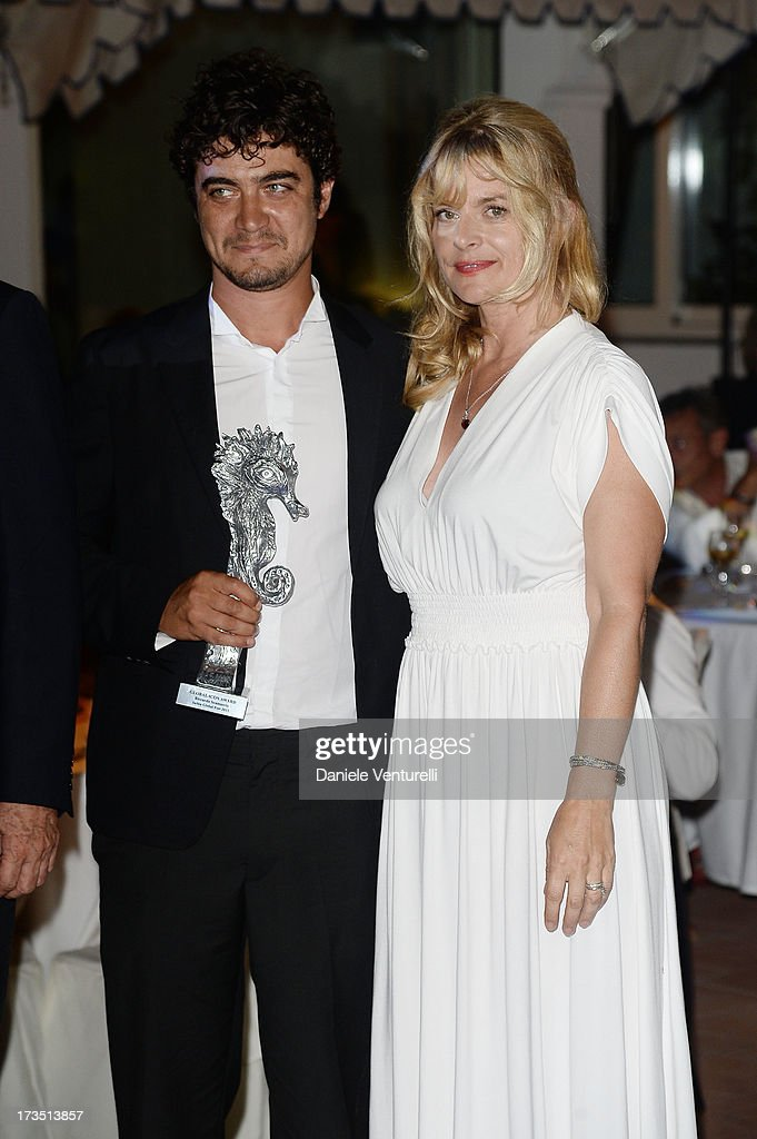 <a gi-track='captionPersonalityLinkClicked' href=/galleries/search?phrase=Riccardo+Scamarcio&family=editorial&specificpeople=816804 ng-click='$event.stopPropagation()'>Riccardo Scamarcio</a> and <a gi-track='captionPersonalityLinkClicked' href=/galleries/search?phrase=Nastassja+Kinski&family=editorial&specificpeople=813458 ng-click='$event.stopPropagation()'>Nastassja Kinski</a> attend the Day 3 of Ischia Global Fest 2013 on July 15, 2013 in Ischia, Italy.
