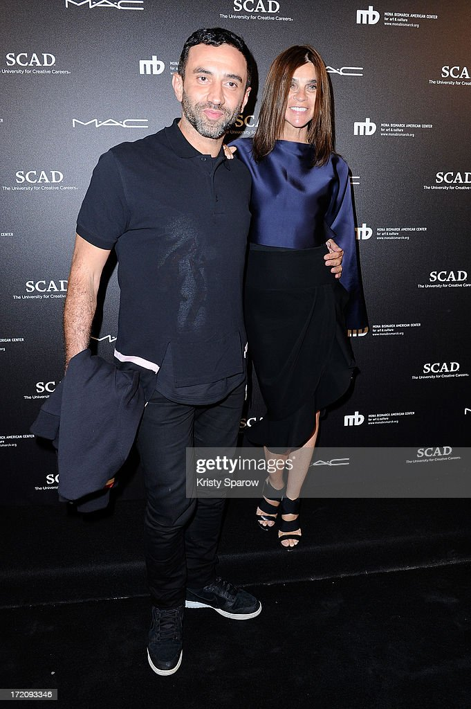 <a gi-track='captionPersonalityLinkClicked' href=/galleries/search?phrase=Riccardo+Tisci&family=editorial&specificpeople=2214975 ng-click='$event.stopPropagation()'>Riccardo Tisci</a> and <a gi-track='captionPersonalityLinkClicked' href=/galleries/search?phrase=Carine+Roitfeld&family=editorial&specificpeople=240177 ng-click='$event.stopPropagation()'>Carine Roitfeld</a> attend the Little Black Dress exhibition as part of Paris Fashion Week Haute-Couture F/W 2013-2014 on July 1, 2013 in Paris, France.